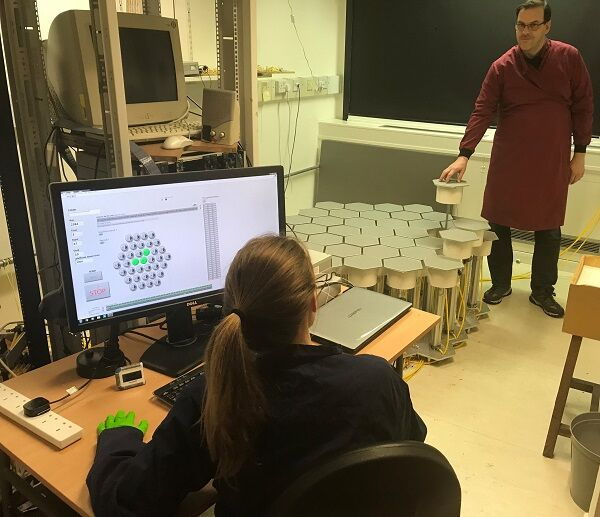 Researchers with the honeycomb maze and computer interface