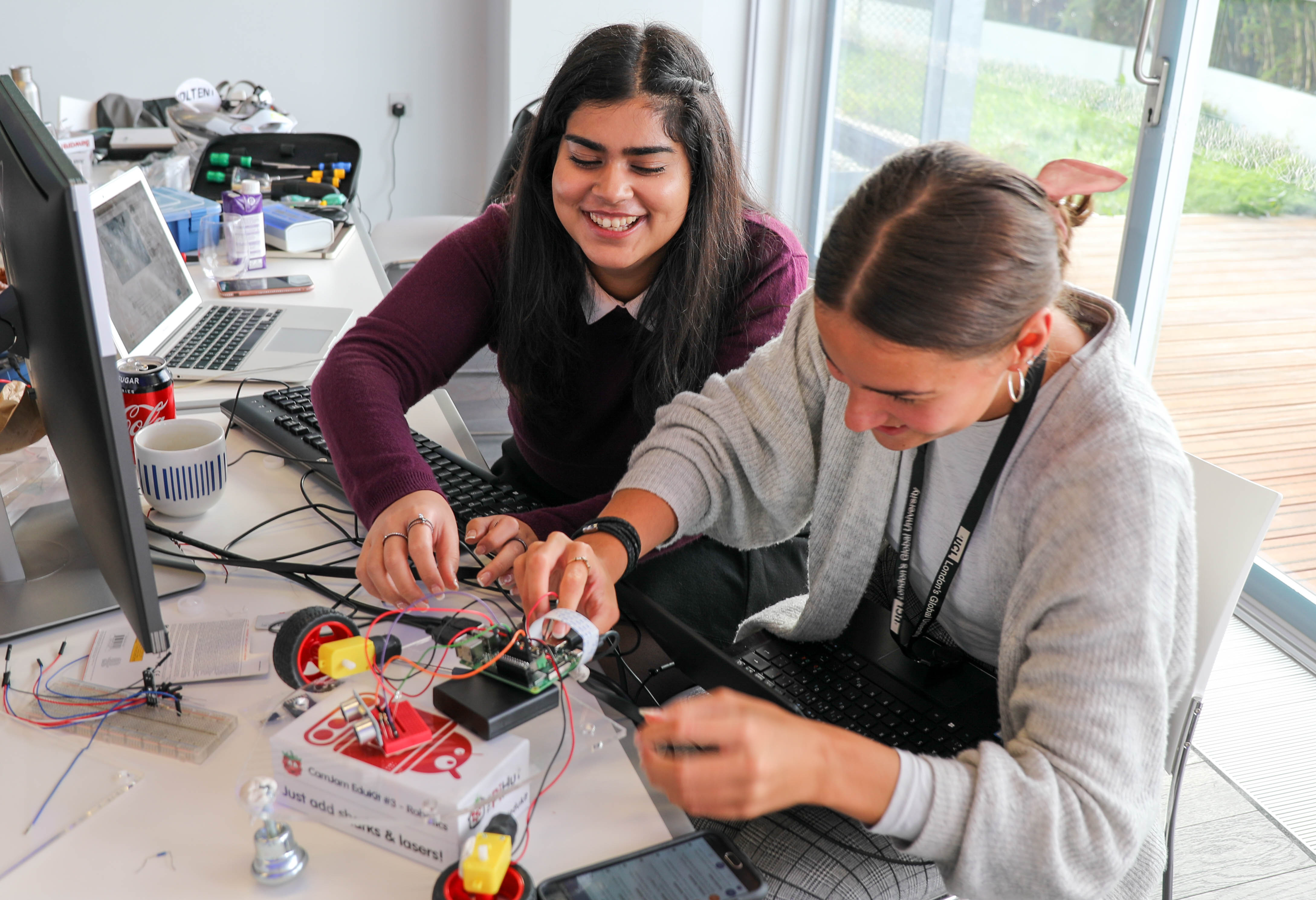 Photo of two SWC students building a robot during boot camp