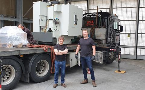 FabLabs engineers Del Halpin and Simon Townsend receive the new milling machine at the SWC